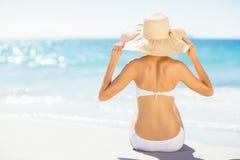 Woman taking sunbath on beach Stock Photos