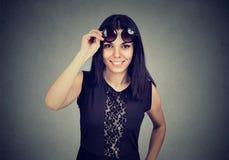 Woman taking of sunglasses smiling looking at camera Royalty Free Stock Photos