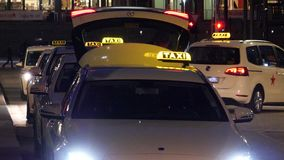 Woman taking a taxi in Germany, Hamburg at night stock video footage