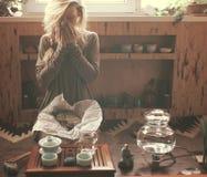 Woman taking tea. Preparing for tea ceremony stock photos