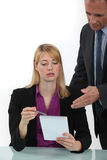Woman taking to her boss Stock Images