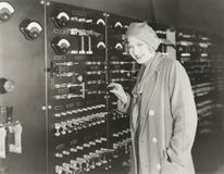 Woman taking a tour of 1930s recording studio Stock Photography