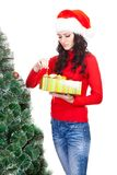 Woman taking toy for artifical fur tree Stock Photo