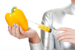 woman taking vitamins from sweet pepper Stock Photo