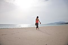 Woman taking for a walk at Tarifa beach Royalty Free Stock Photos