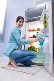 Woman taking a water bottle Stock Photo