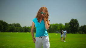The woman talk on the phone at the course stock footage
