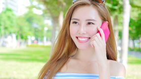 Woman talk on phone. In the park Stock Image