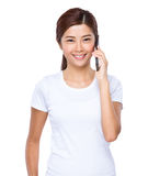 Woman talk to cell phone. Isolated on white background Stock Image