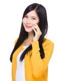 Woman talk to cellphone Stock Photos