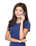 Woman talk to cellphone Stock Images