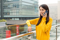 Woman talk to cellphone Stock Photos