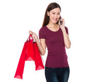 Woman talk to cellphone and shopping bag Stock Photo