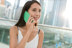 Woman talk to mobile phone. Asian young woman Stock Photo