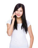 Woman talk to mobile phone Royalty Free Stock Photo