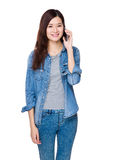 Woman talk to mobile phone Stock Images