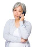 Woman talk to phone Stock Photo