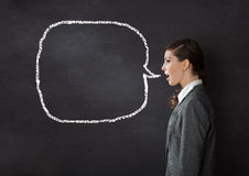 Woman talking blackboard Royalty Free Stock Photo
