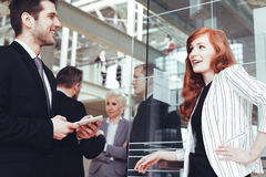 Woman talking with business partner Stock Images