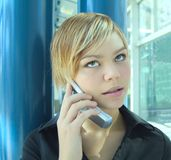 Woman talking on cell. A woman talking on a cell phone Royalty Free Stock Photos