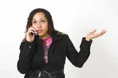 Woman talking on cell phone. Woman waving her arm as she speaks into a cell phone Royalty Free Stock Photos