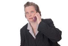 Woman talking on cell phone. Very attractive young woman talking on a mobile cell phone Isolated over white Royalty Free Stock Image