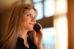 Woman talking cell phone Stock Images