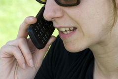 Woman talking on cell phone Stock Photos