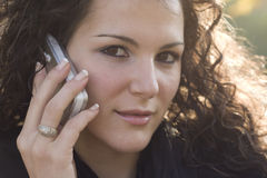Woman talking by cell phone Stock Photos