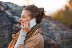 Woman talking cell phone in autumn outdoors Stock Photos