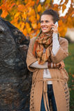 Woman talking cell phone in autumn outdoors Royalty Free Stock Images