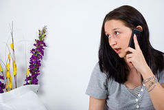 Woman talking at cell phone in bed Stock Photos