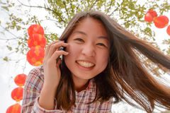 Woman talking on cell phone during chinese new year Royalty Free Stock Photography
