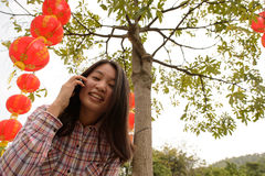 Woman talking on cell phone during chinese new year Stock Images