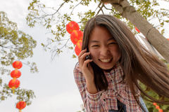 Woman talking on cell phone during chinese new year Royalty Free Stock Image