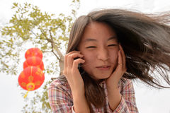 Woman talking on cell phone during chinese new year Stock Photography