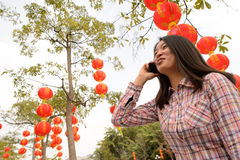 Woman talking on cell phone during chinese new year Stock Image