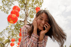 Woman talking on cell phone during chinese new year Stock Photos