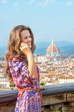 Woman talking cell phone in florence, italy Stock Photos