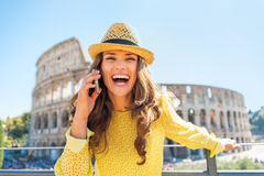 Woman talking cell phone in front of colosseum Stock Image