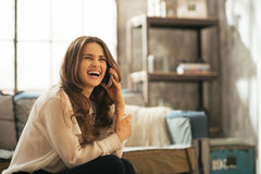 Woman talking cell phone in loft apart Royalty Free Stock Images