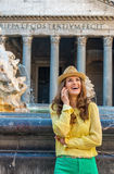 Woman talking cell phone near fountain in rome Royalty Free Stock Photos