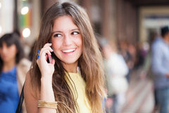 Woman talking on the cell phone Royalty Free Stock Photos