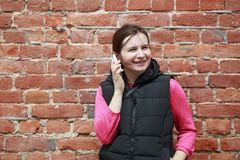 Woman talking on a cell phone Royalty Free Stock Photos