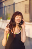 Woman talking on cell phone in the street Royalty Free Stock Image