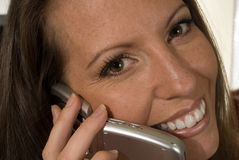 Woman talking on cellphone. Closeup portrait of a woman talking or using a cellphone Royalty Free Stock Image