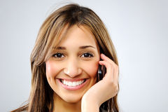 Woman talking on cellphone Stock Image