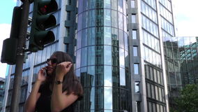 Woman Talking With Cellphone and Business Towers in City. Video stock footage