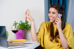 Woman talking on cellphone looking happy Stock Photography