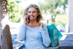 Woman talking on cellphone at street Stock Images